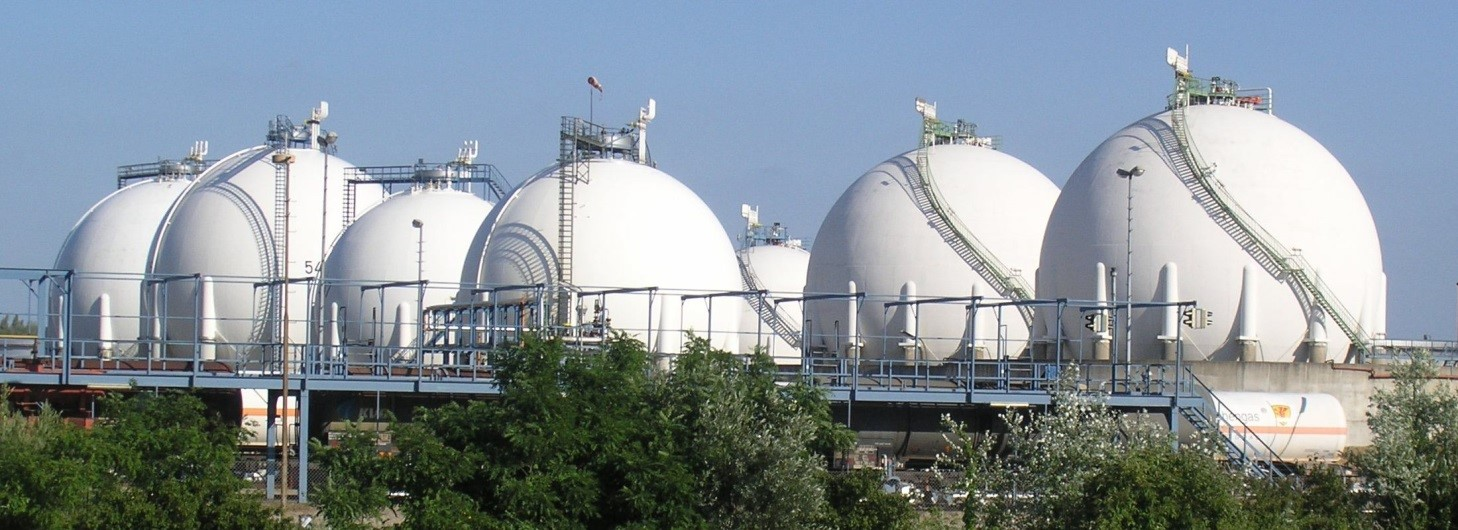 Multiple tanks forming a tank farm at an outdoor chemical plant